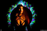 Woman with rainbow lighting. Light painting photograph.