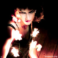Woman with illuminated flowers. Light painting photograph.