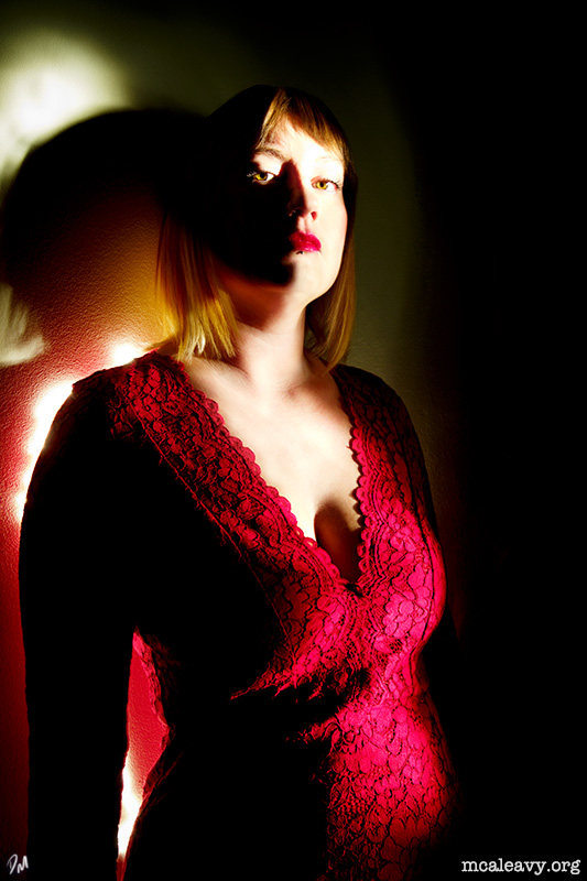 Woman in a red dress. Light painting photograph.