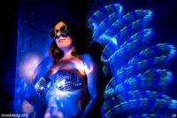 Woman wearing mirror bra. Light painting photograph.