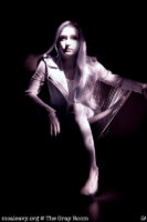 Woman in basket chair. Infrared light painted photograph.