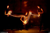 Woman playing saxophone. Light painted photograph.
