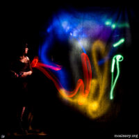 Artist painting with light. Light painted photograph.