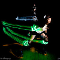 Roller derby skater with light streaks. Light painted photograph.