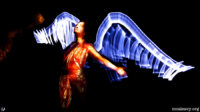 Woman with wings of light. Light painting photograph.