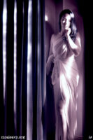 Woman with toga. Infrared light painted photograph.