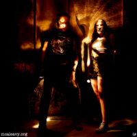 A couple of miscreants wearing masks. Light painted photograph.