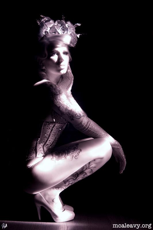 Burlesque portrait of Debay Deluxe. Light painting photograph.