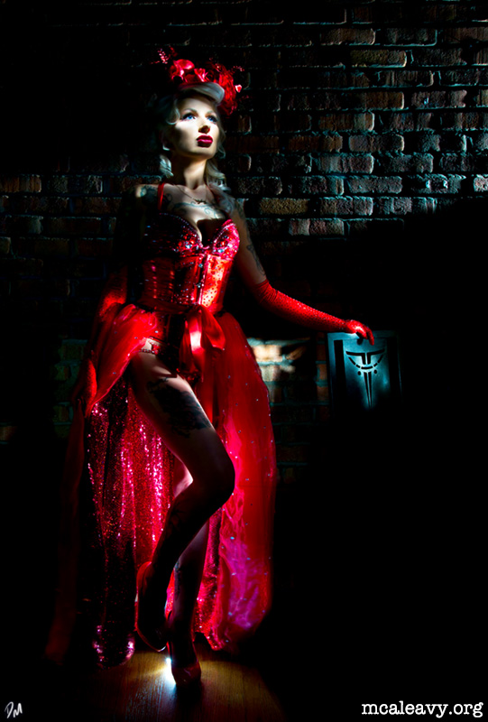 Debay Deluxe in a red Burlesque costume. Light painting photograph.